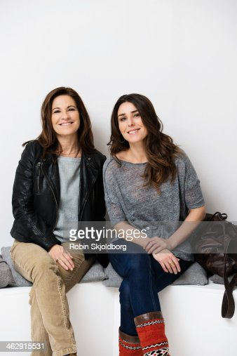 Mature woman with daughter smiling