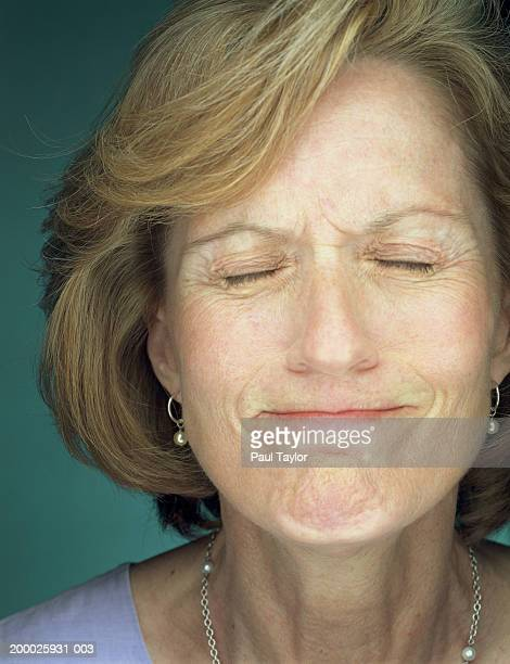 Mature woman with eyes closed, close-up