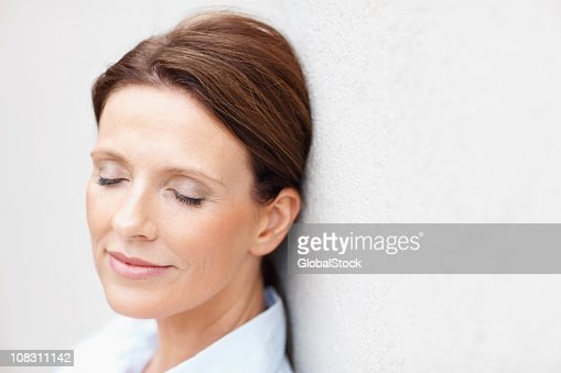 Mature woman with eyes closed