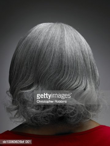 Mature woman with grey hair, rear view, head and shoulders : Stock Photo