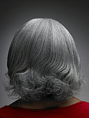 Mature woman with grey hair, rear view, head and shoulders