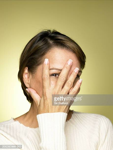 Mature woman with hand over face