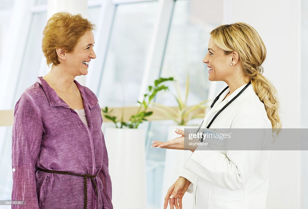 Mature woman with her doctor. : Stock Photo
