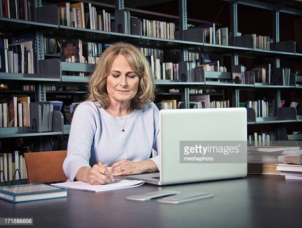 Mature Woman With Laptop Working On Something