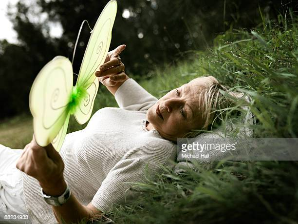Mature woman with model butterfly