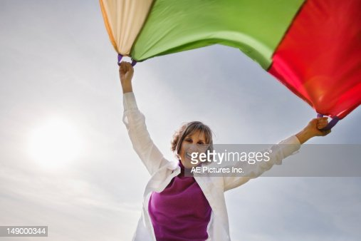 Mature woman with parachute : Stock Photo
