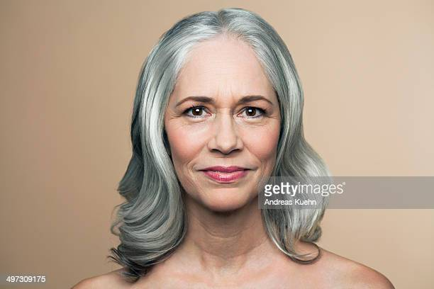 Mature woman with silvery grey hair, portrait.