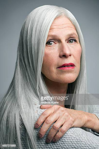 Mature woman with straight grey hair, portrait.