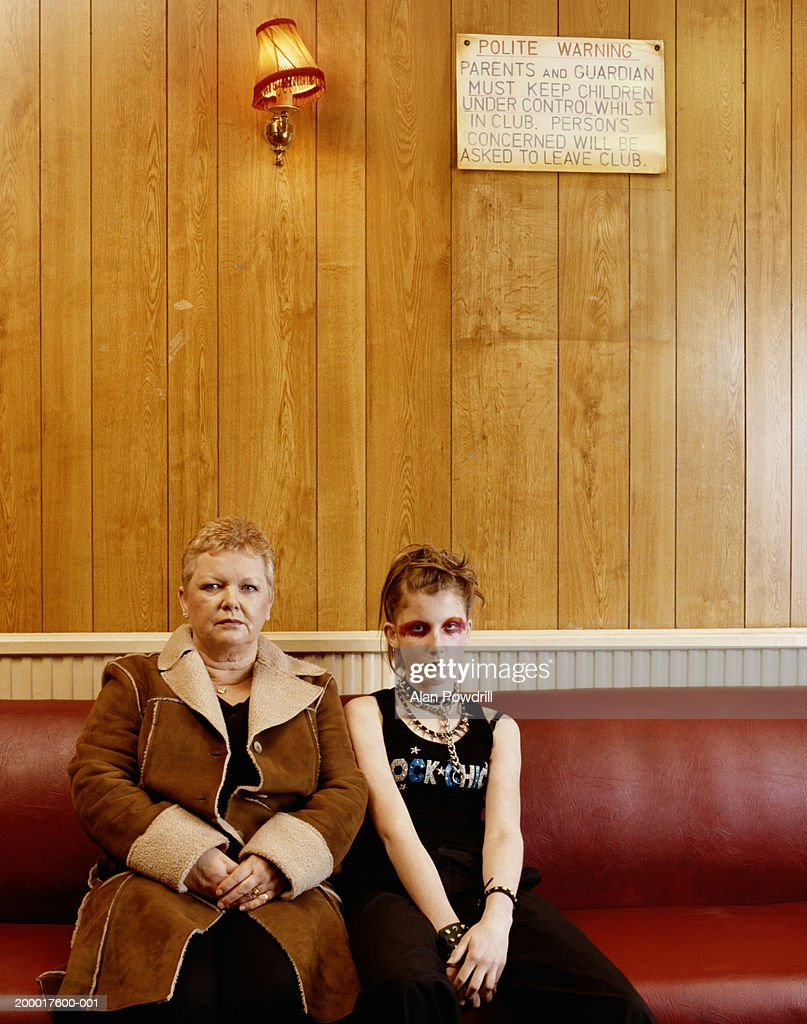 Mature woman with teenage girl (14-16) dressed as punk, portrait : Stock Photo