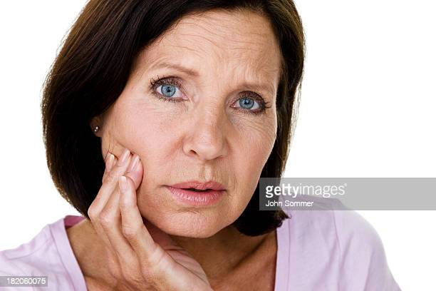 Mature woman with toothache