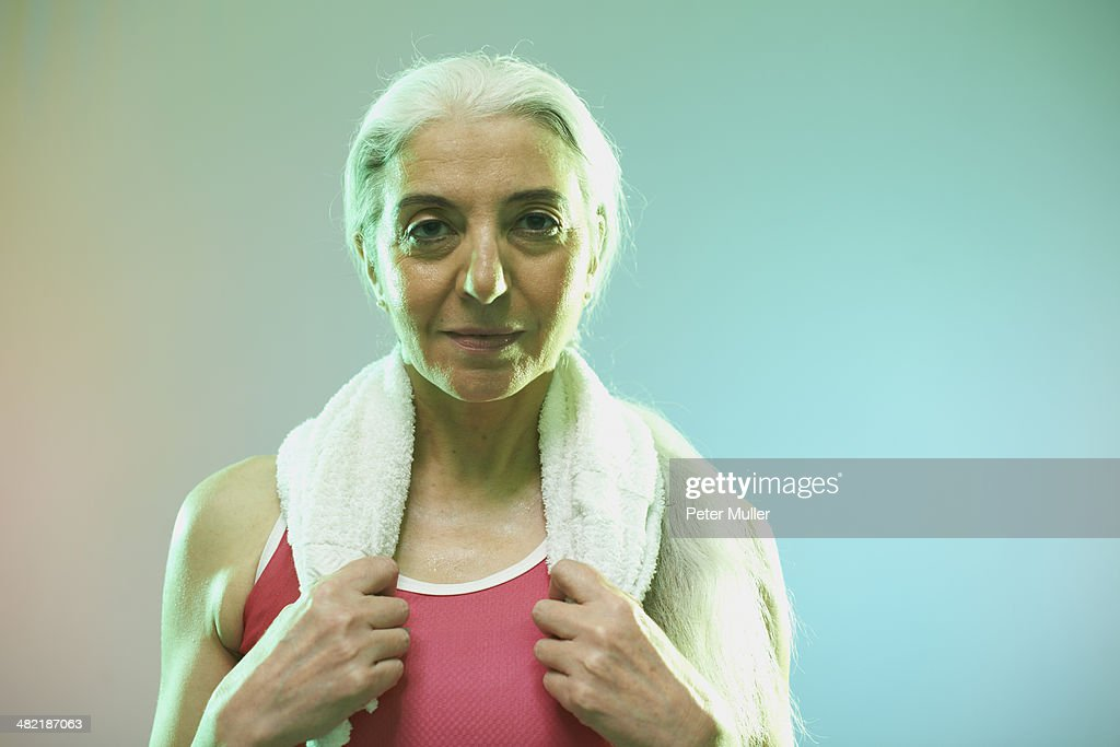 Mature woman with towel around neck : Stock Photo
