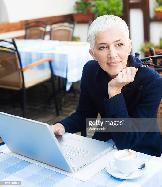 Mature woman working at caffe