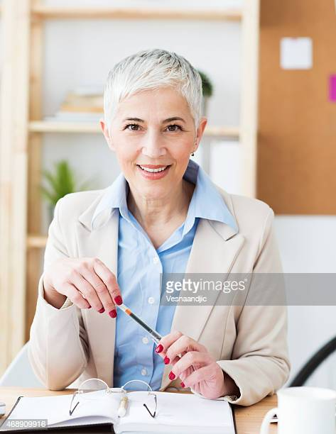 A mature woman working in an office
