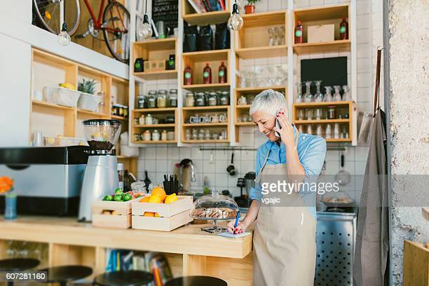 Mature Woman Working In Her Cafe