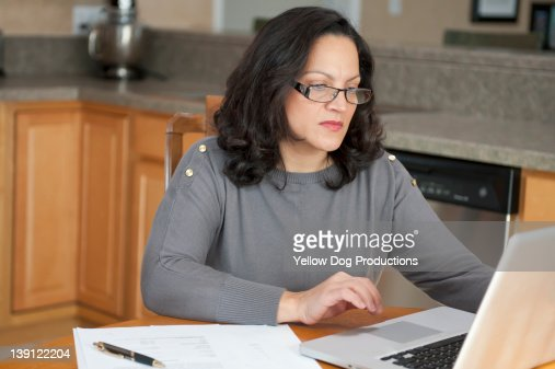 Mature Woman Working on Computer at Home : Stock Photo