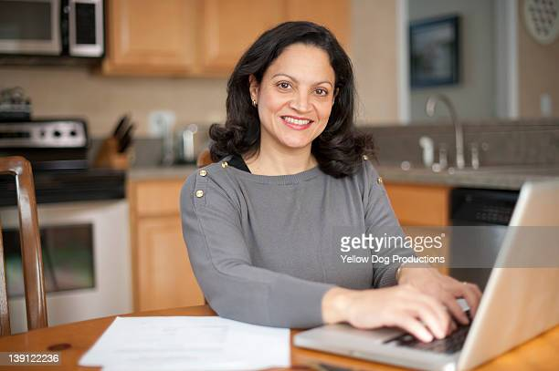 Mature Woman Working on Computer at Home
