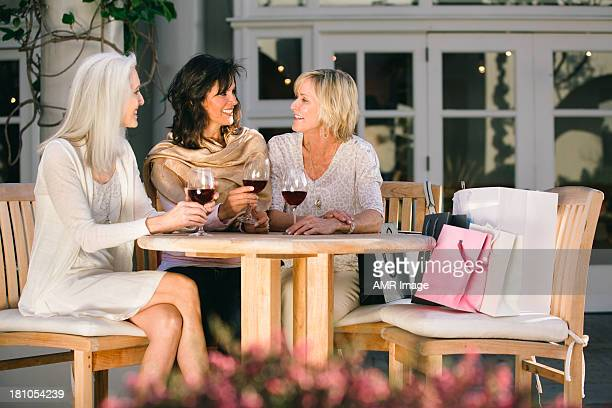 Mature women drinking red wine