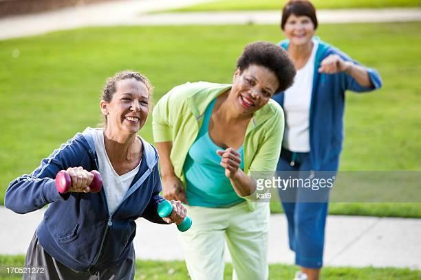 Mature women exercising outdoors