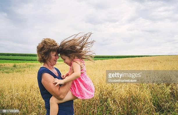 Mature women lifting up baby girl