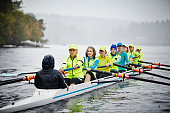 Mature women rowing eight person rowing shell