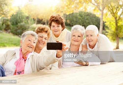 Mature women taking a Selfie