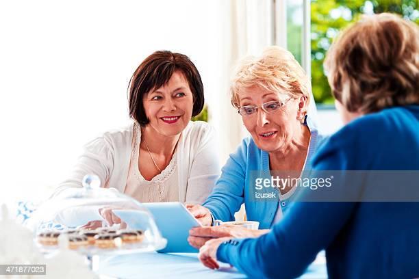 Mature women using digital tablet