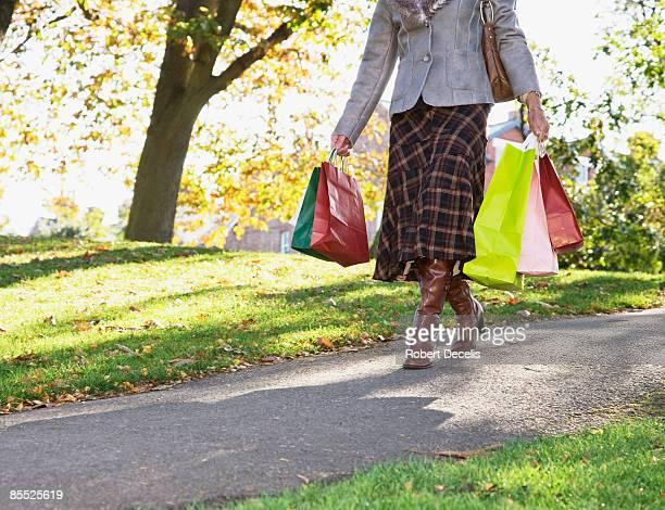 Mature women walking, holding shopping bags