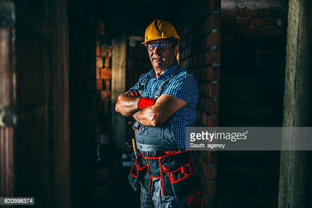 Mature worker with tool belt