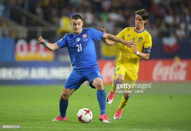 Matus Bero of Slovakia and Kristoffer Olsson of Swedn battle for possession during the UEFA European Under21 Championship Group A match between...