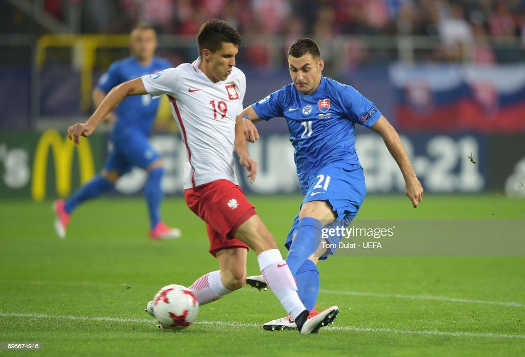 Matus Bero of Slovakia shoots past Bartosz Kapustka of Poland during the UEFA European Under-21 Championship match between Poland and Slovakia at Lublin Stadium on June 16, 2017 in Lublin, Poland.
