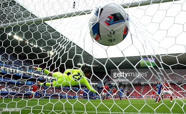 Matus Kozacik of Slovakia dives in vain as Gareth Bale of Wales scores his team's first goal during the UEFA EURO 2016 Group B match between Wales...
