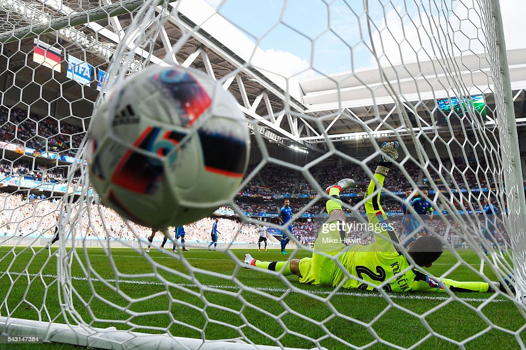 Matus Kozacik of Slovakia dives in vain as Jerome Boateng of Germany scores the opening goal during the UEFA EURO 2016 round of 16 match between Germany and Slovakia at Stade Pierre-Mauroy on June 26, 2016 in Lille, France.