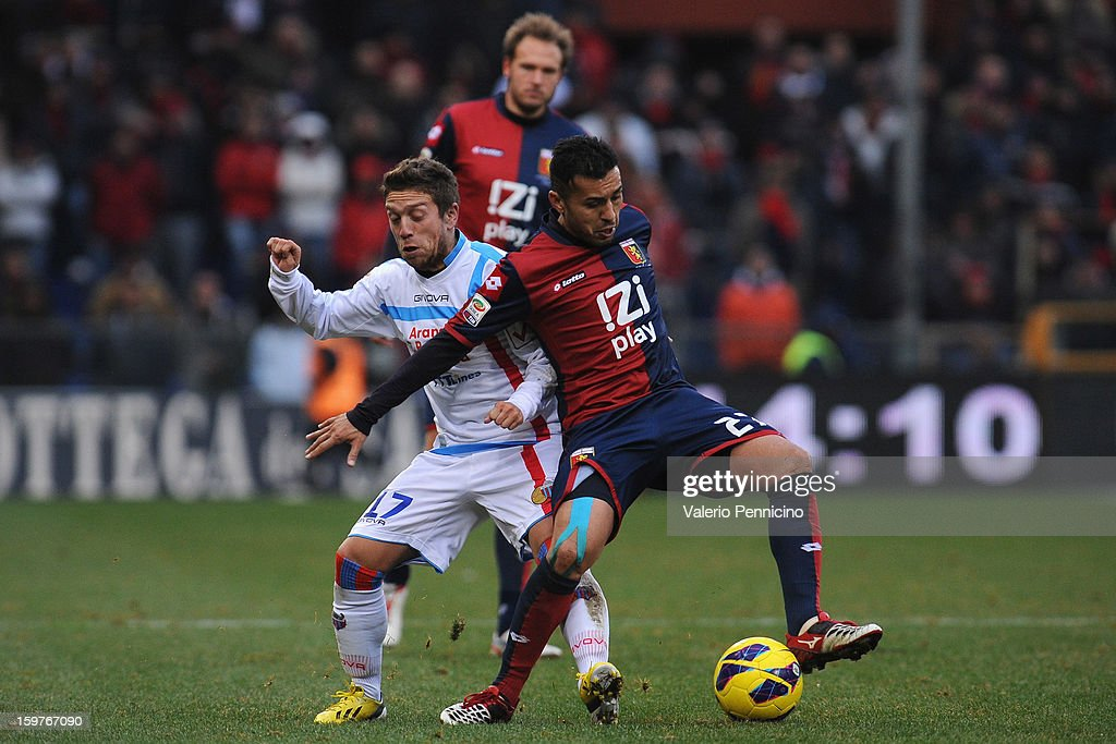 Matuzalem (R) of Genoa CFC competes with Alejandro Dario Gomez of Calcio Catania during the Serie A match between Genoa CFC and Calcio Catania at Stadio Luigi Ferraris on January 20, 2013 in Genoa, Italy.