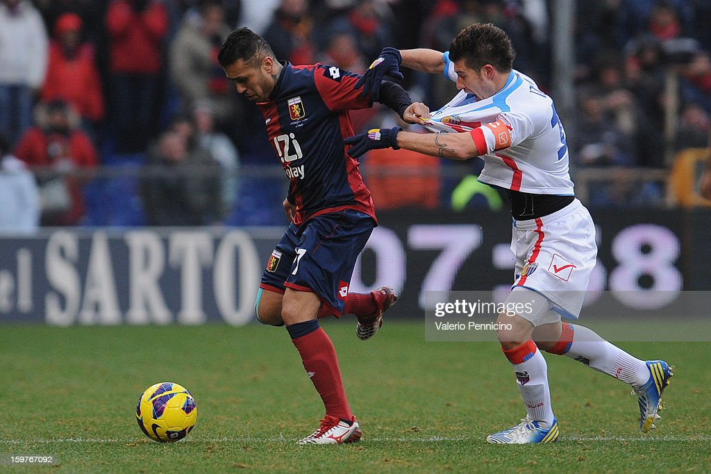 Matuzalem (L) of Genoa CFC is challenged by Mariano Julio Izco of Calcio Catania during the Serie A match between Genoa CFC and Calcio Catania at Stadio Luigi Ferraris on January 20, 2013 in Genoa, Italy.
