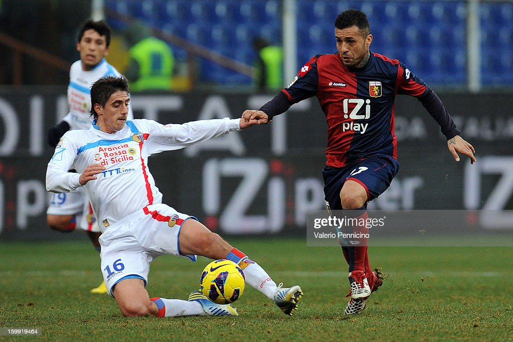 Matuzalem (R) of Genoa CFC is challenged by Mario Angel Paglialunga of Calcio Catania during the Serie A match between Genoa CFC and Calcio Catania at Stadio Luigi Ferraris on January 20, 2013 in Genoa, Italy.