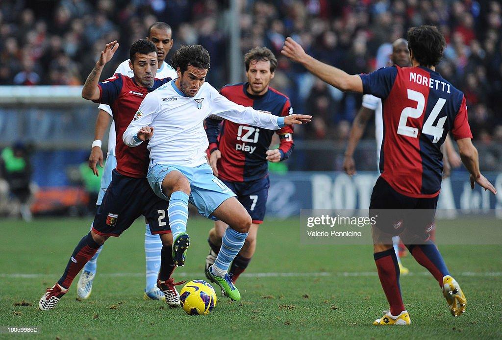 Matuzalem (L) of Genoa CFC is competes with Alvaro Gonzalez of S.S. Lazio during the Serie A match between Genoa CFC and SS Lazio at Stadio Luigi Ferraris on February 3, 2013 in Genoa, Italy.