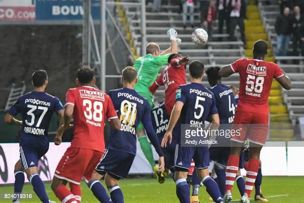 ANTWERP BELGIUM JULY Matz Sels from Anderlecht punches the ball away from Dylan Batubinsika from Antwerp during the Jupiler League match between...