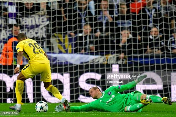 Matz Sels goalkeeper of RSC Anderlecht battles for the ball with Kylian Mbappe forward of PSG during the Champions League Group B match between RSC...