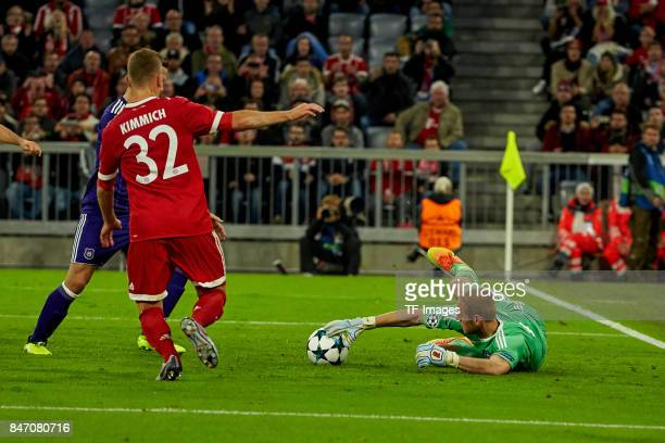 Matz Sels of Anderlecht and Joshua Kimmich of Bayern Muenchen battle for the ball during the UEFA Champions League group B match between Bayern...