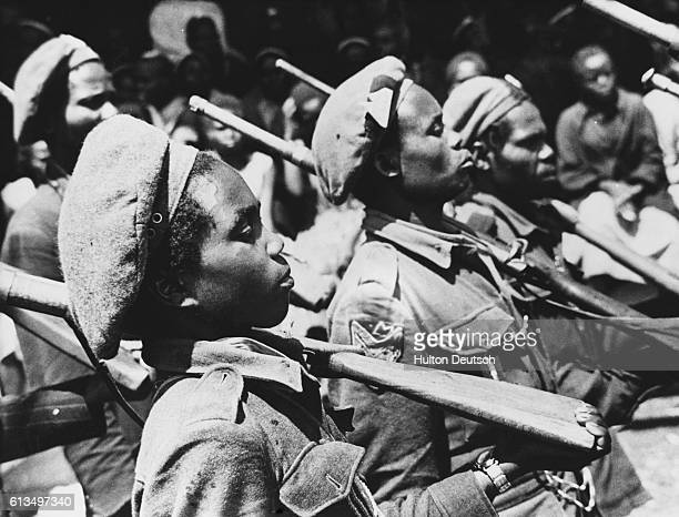 Mau Mau soldiers at their military camp in a crater | Location Meurland Kenya