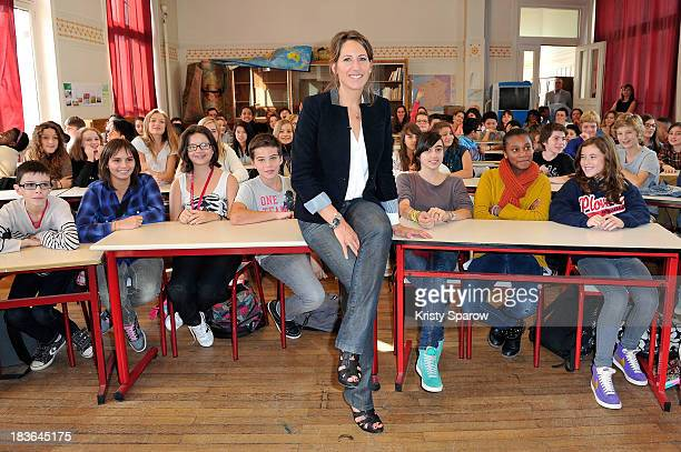Maud Fontenoy poses with school children during her launch to supply teaching equipment for schools at Lycee Jules Ferry in Paris on October 8 2013...
