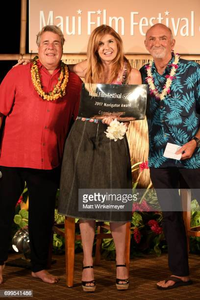 Maui Film Festival Director Barry Rivers Connie Britton receipient of the Navigator Award and Rick Chatenever pose onstage at the 'Celestial Cinema'...