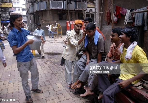 Maula Ali the ear cleaner at work at Zaveri Bazaar where one of the triple blasts took place on July 13 2011