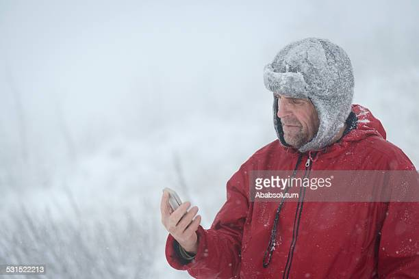 Mauntain Senior Man with Smart Phone, Snowing, Alps, Europe
