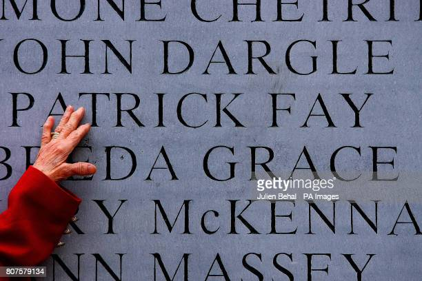 Maura Fay from Artane Dublin touches the name of her late husband Patrick on the memorial on Talbot Street to the 1974 Dublin and Monaghan Bombings...