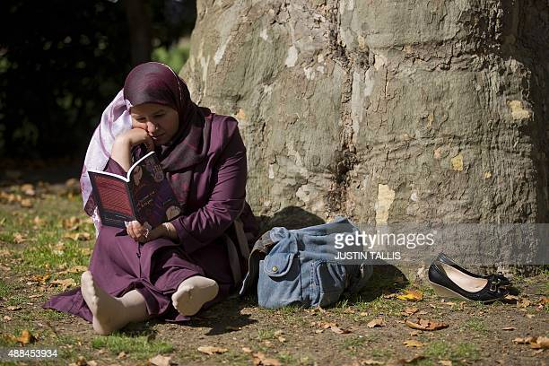 Maureen Cofflard Iraqi academic Nadia Faydh poses for a photograph in a central London park on September 11 2015 after leaving Iraq following...