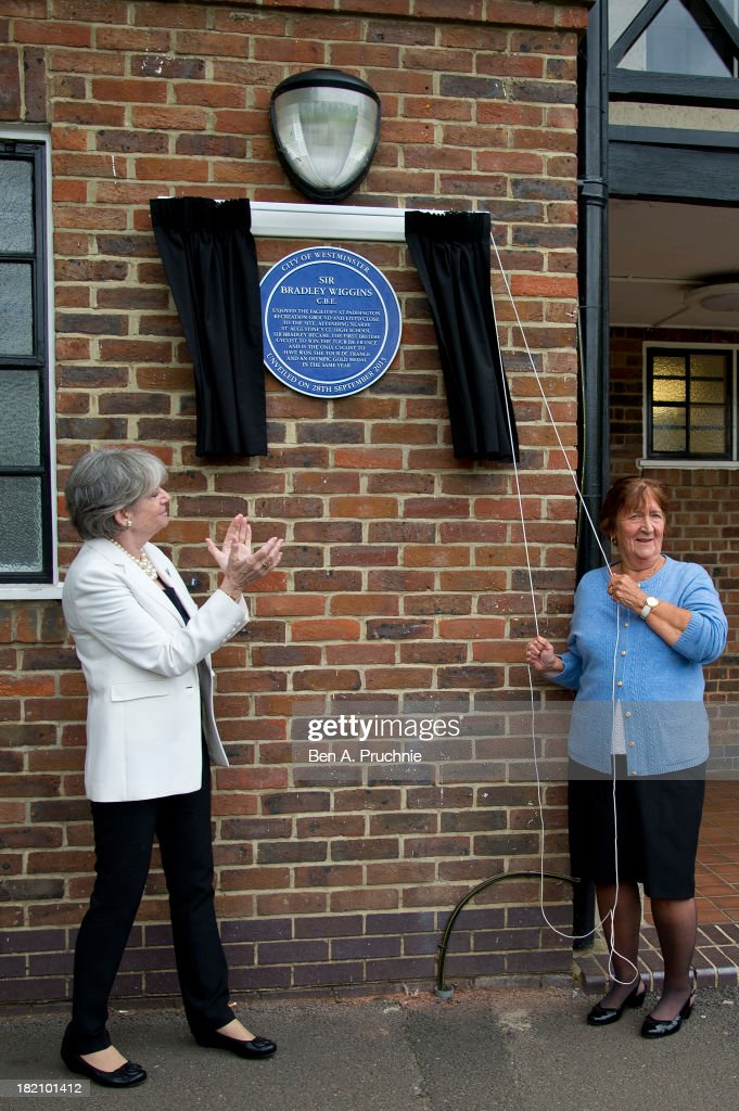 Maureen Cousins (R), grandmother of Sir Bradley Wiggins, unveils a blue plaque on the recreation ground where he learned to ride his bike at Paddington Recreation Ground on September 28, 2013 in London, England.