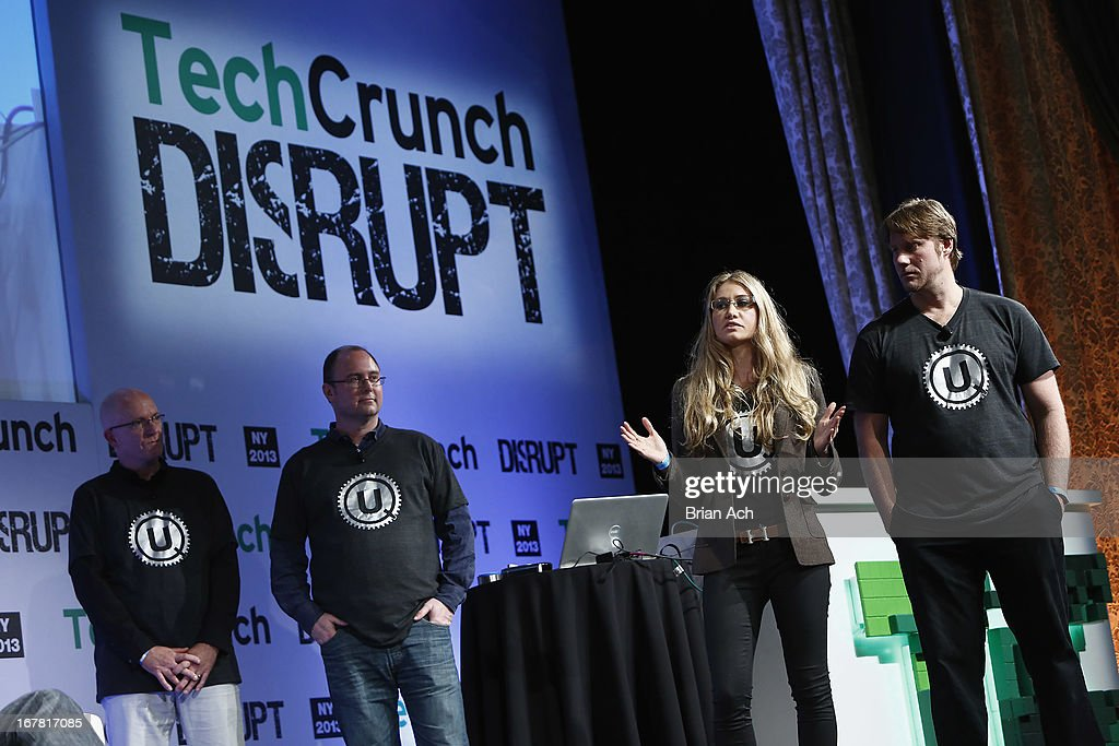 Maureen Dunne (C) presents UQ onstage with Dave White, Brett Manning and Jim Pearson at the TechCrunch Disrupt NY 2013 at The Manhattan Center on April 30, 2013 in New York City.