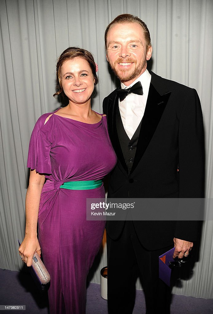 Maureen McCann and <a gi-track='captionPersonalityLinkClicked' href=/galleries/search?phrase=Simon+Pegg&family=editorial&specificpeople=206280 ng-click='$event.stopPropagation()'>Simon Pegg</a> arrive at The 14th Annual White Tie and Tiara Ball to Benefit Elton John AIDS Foundation in Association with Chopard at Woodside on June 28, 2012 in Windsor, England. NO UK SALES BEFORE 17TH JULY 2012. NO HELLO, NOW, CLOSER, REVEAL, HEAT, LOOK OR GRAZIA SALES IN THE UK EVER. NO ITALY SALES BEFORE 4TH JULY 2012, NO SPAIN SALES BEFORE 7TH JULY 2012, NO MEXICO SALES BEFORE 1ST AUGUST 2012. All pictures are for editorial use only and mention of 'Chopard' and 'The Elton John Aids Foundation' are compulsory. No sales ever to any jewellers other than Chopard