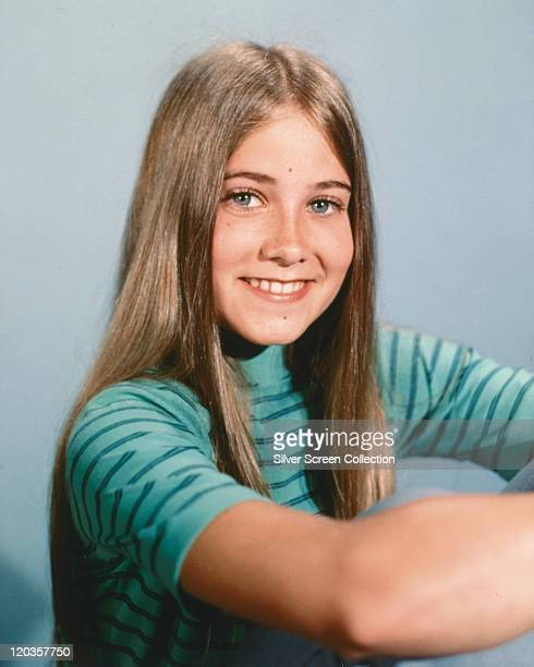 Maureen McCormick US child actress wearing a turquoise tshirt with horizontal blue stripes smiling in a publicity portrait issued for the US...